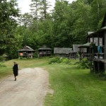 2011 - Young fiddler walking by the Adirondack cabins