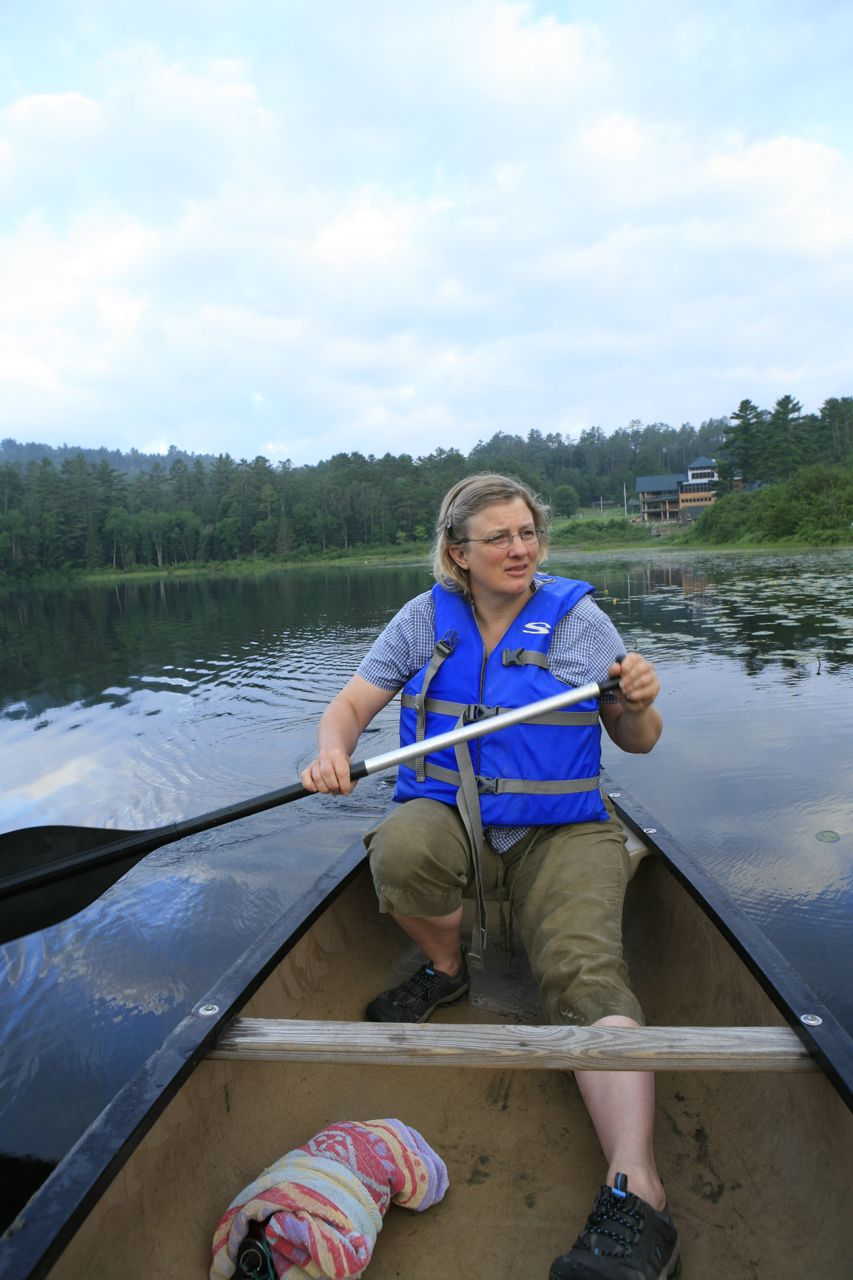 2013 - Theresa on an early morning canoeing trip with Ogontz Hall in the background