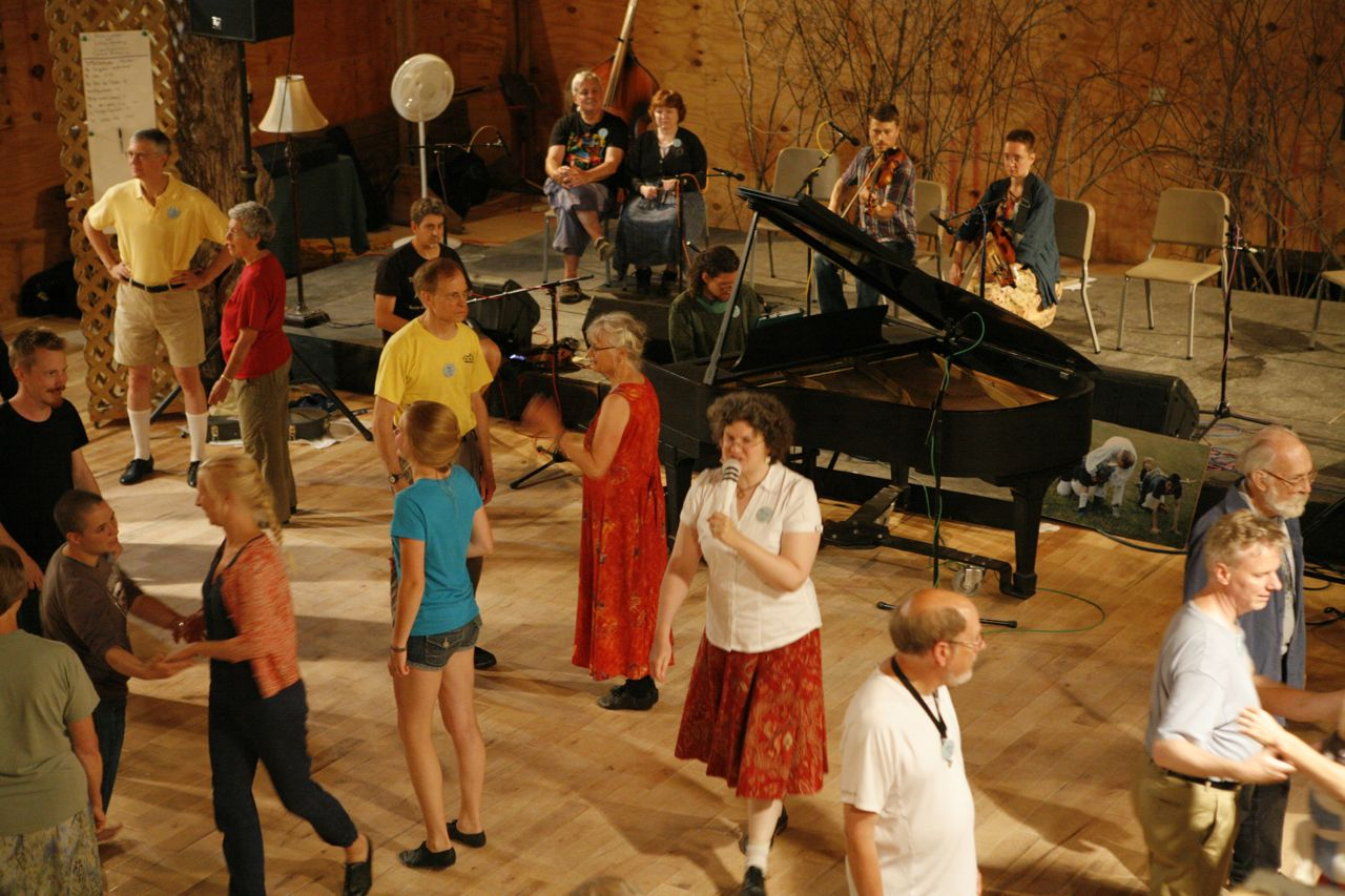 2014 - Melissa calling a contra dance during the early evening American dance party